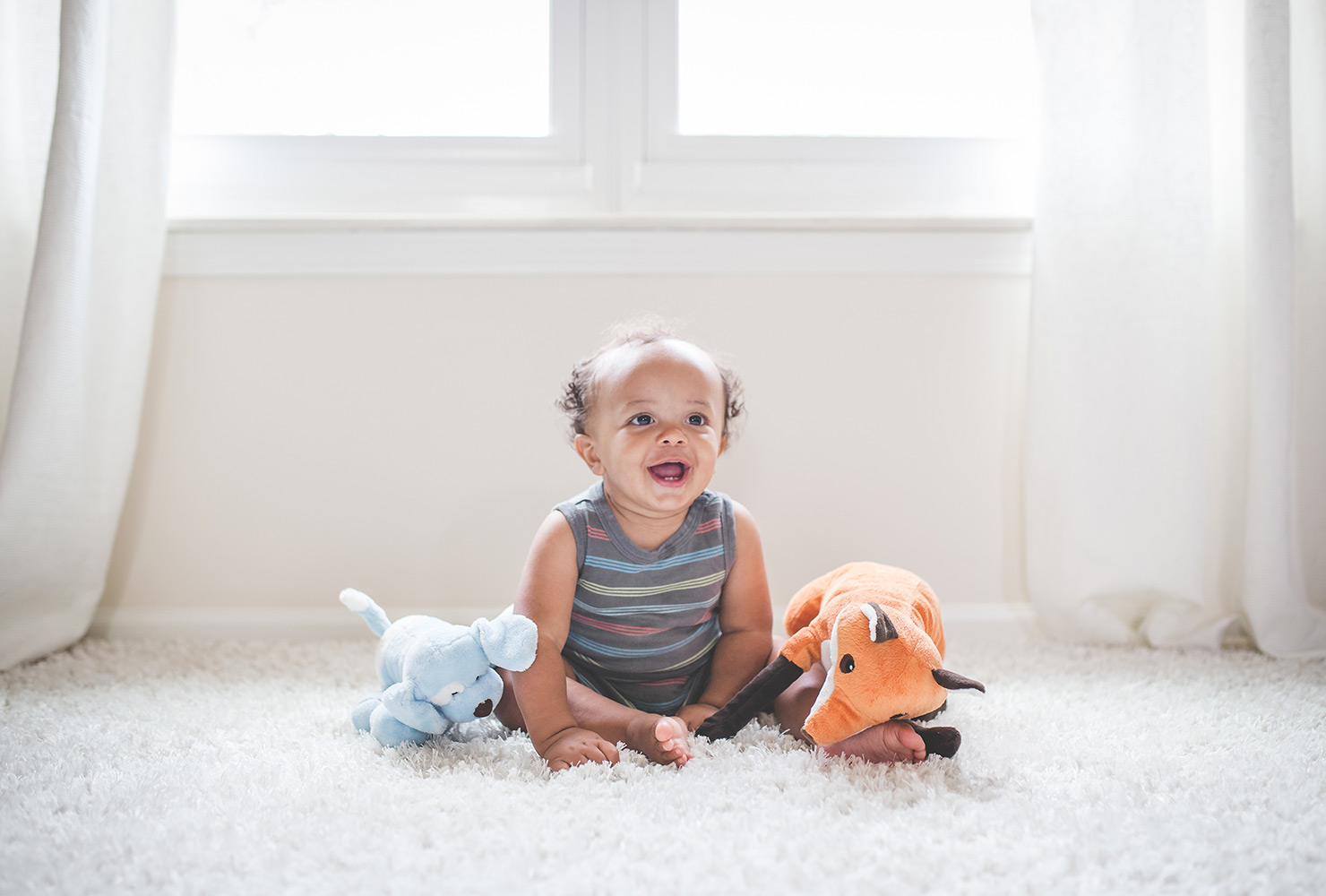 african american newborn with new toys