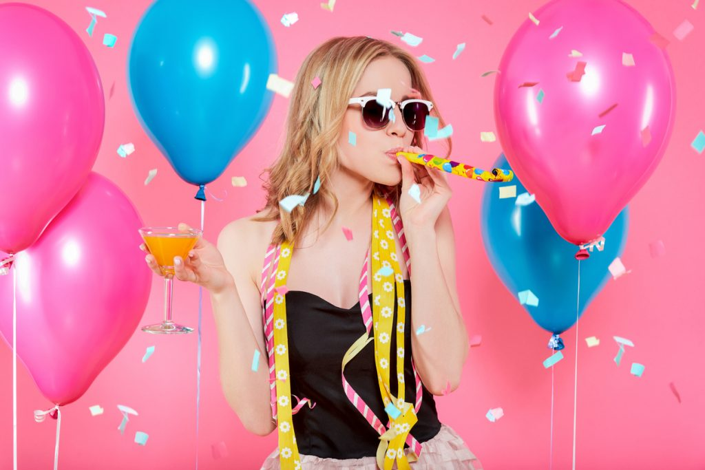 Woman in party outfit celebrating birthday.