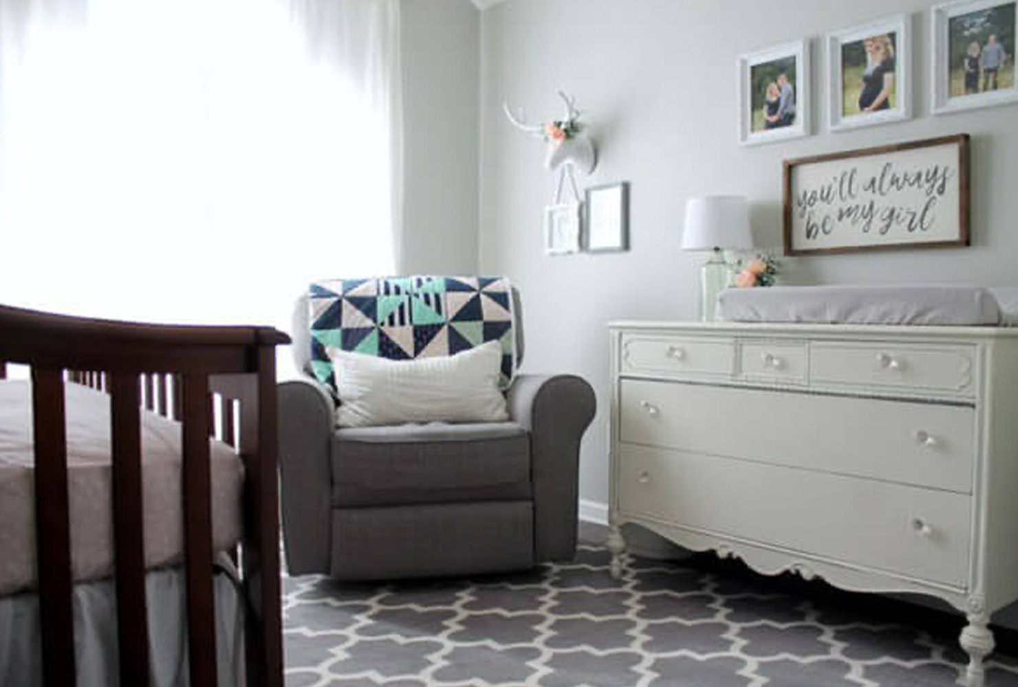 Gray nursery with rocking chair and changing table.