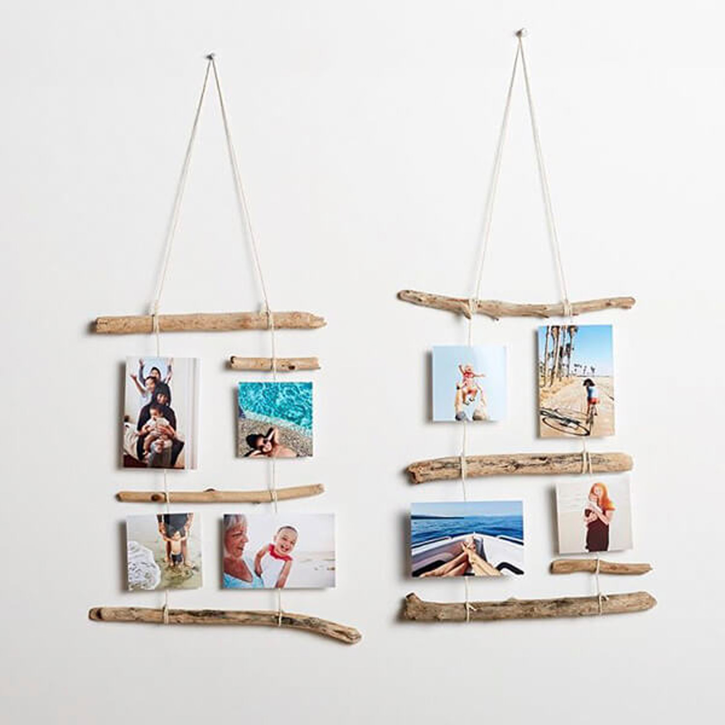 photo display with branches on a wall.