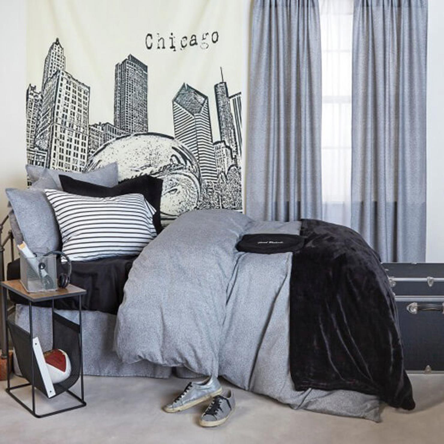 bed with a Chicago city drape next to it.