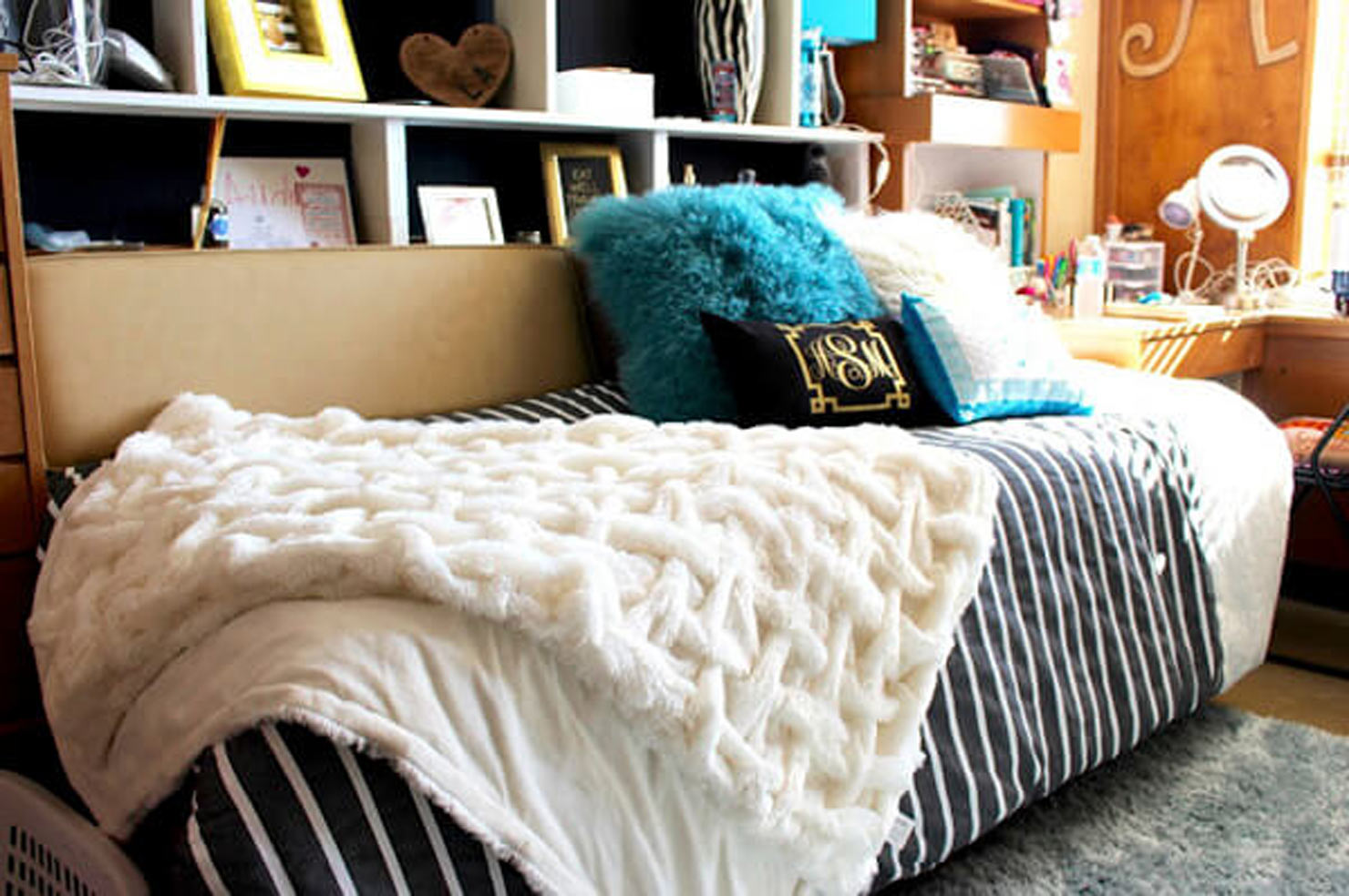 a cozy bed with layered blankets and pillows.