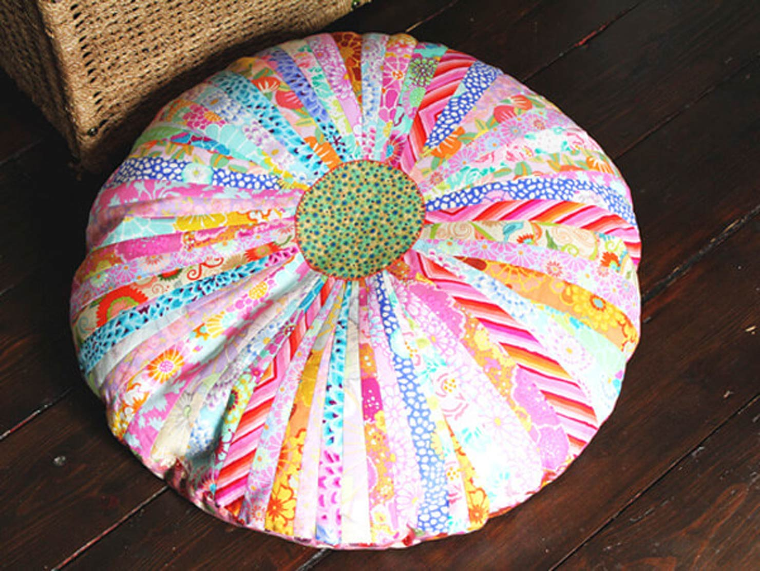 a bean bag made with colorful fabrics.