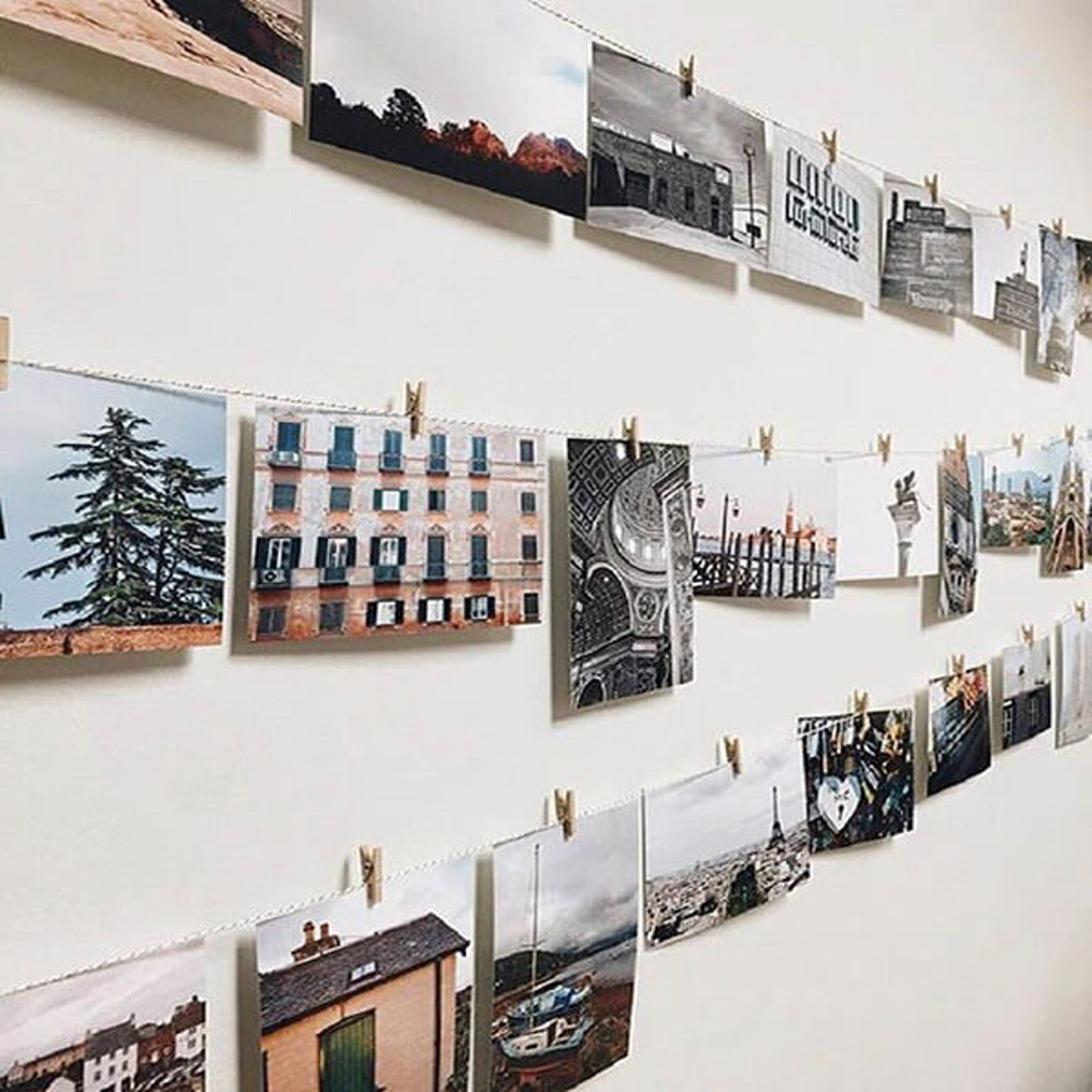 a photo wall created with strings and photos.