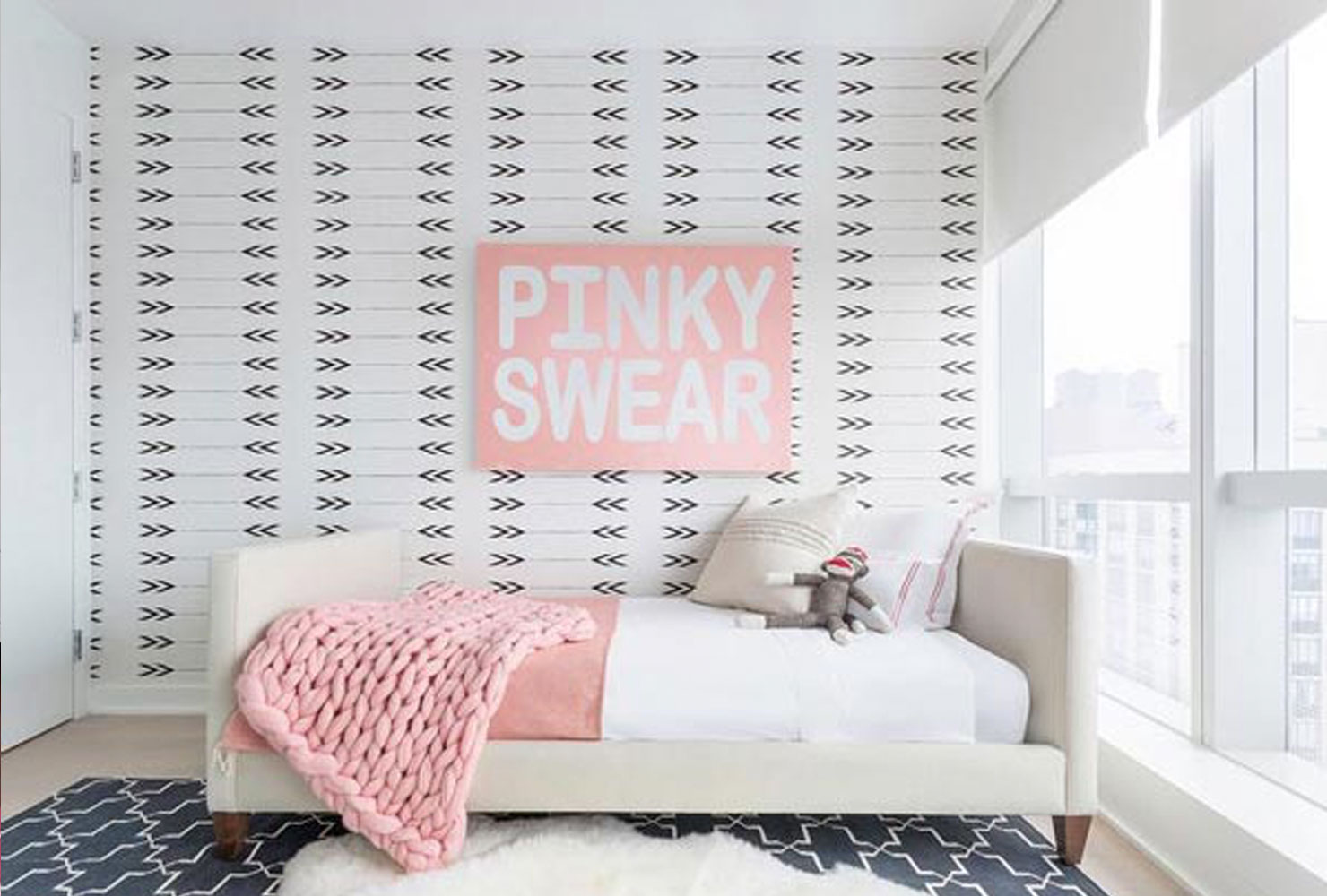 Pink and white girls bedroom decor.