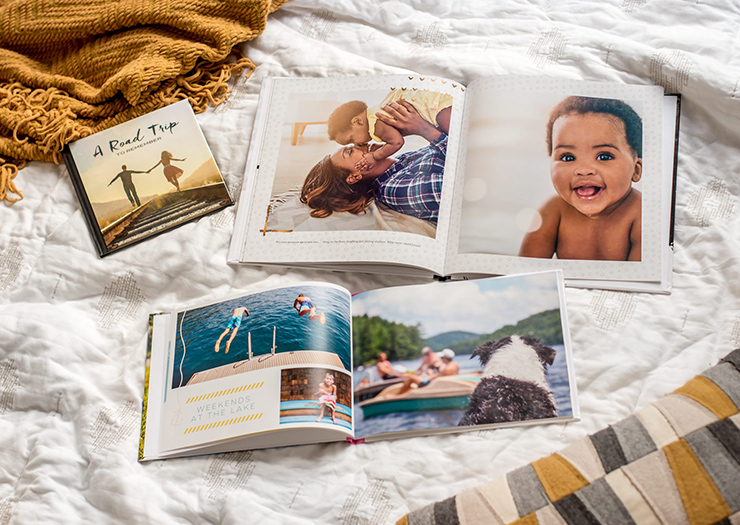 different sizes of photo books on a bed