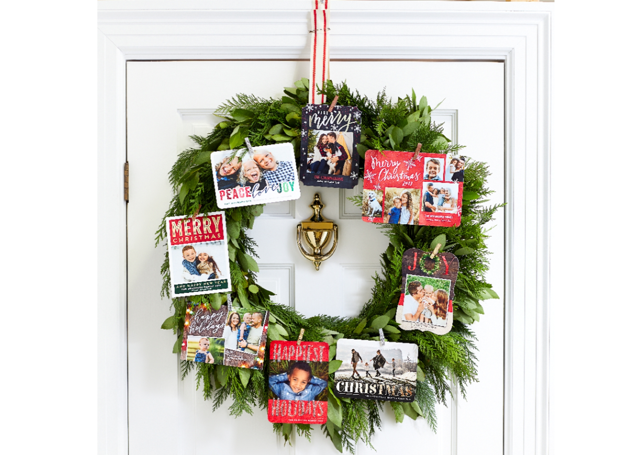 holiday cards hanging on wreath