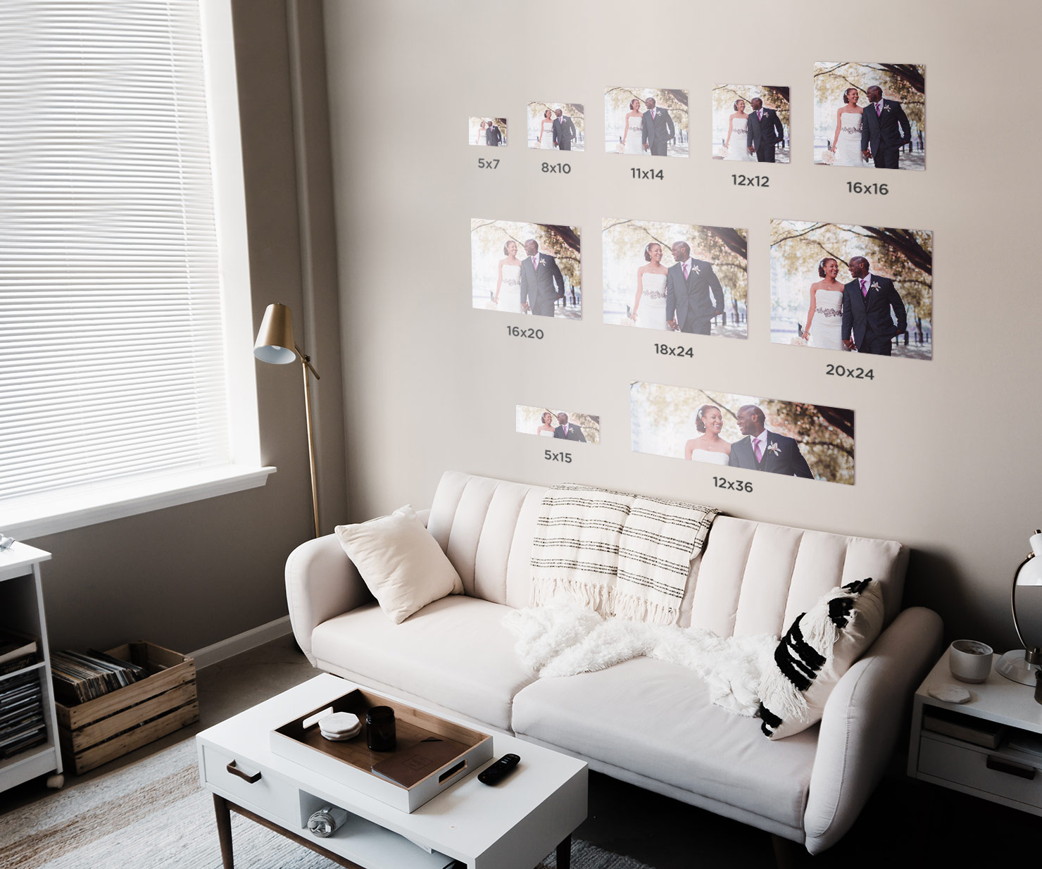 wall gallery above a couch of different sized photos