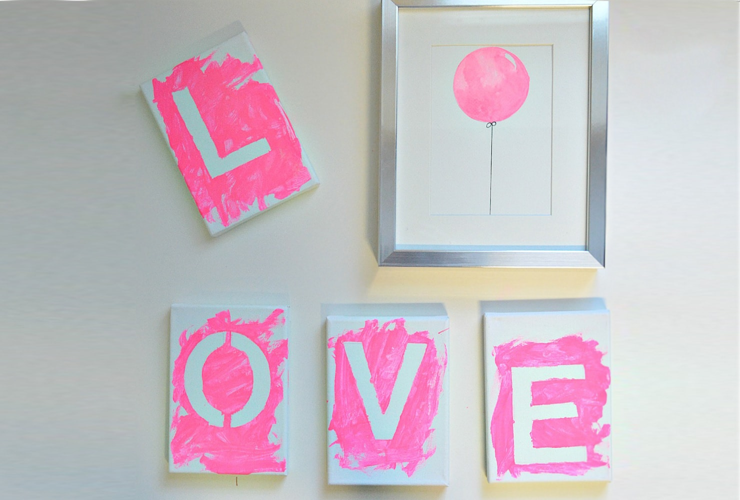 pink canvas with white letters