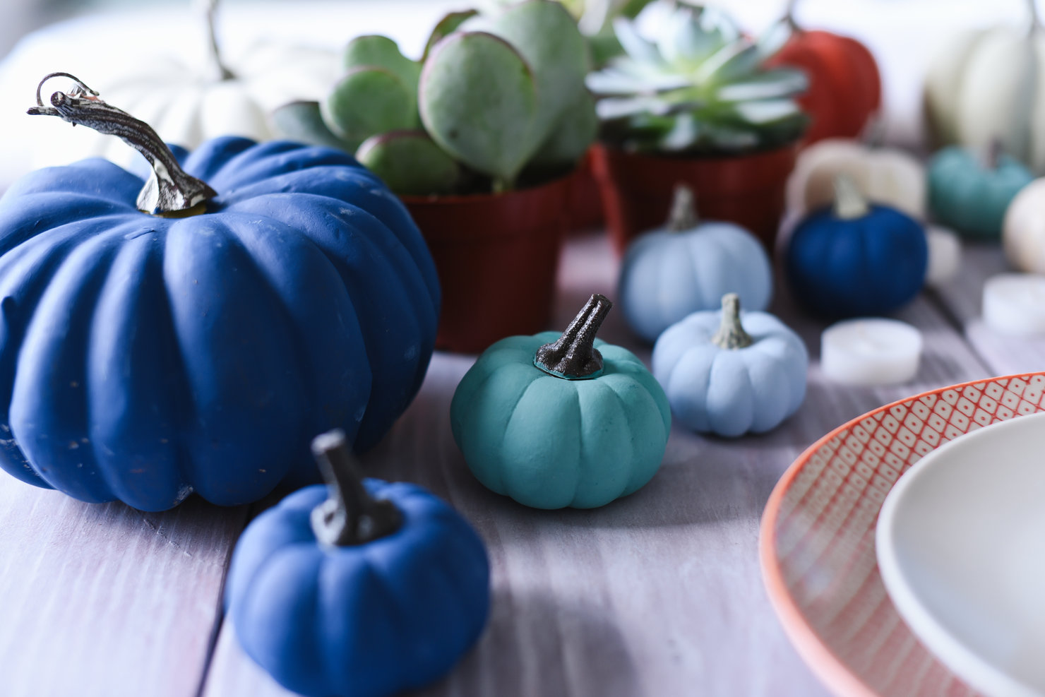 painted pumpkins sit on table
