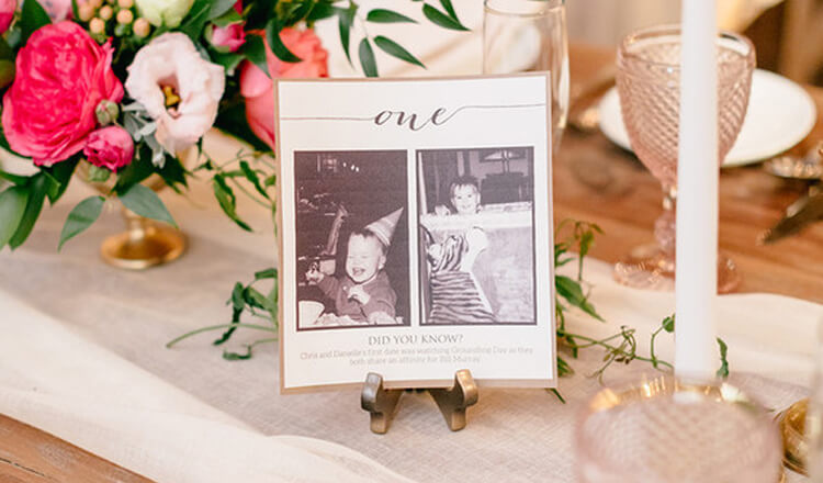 table number with black and white photos of a kid
