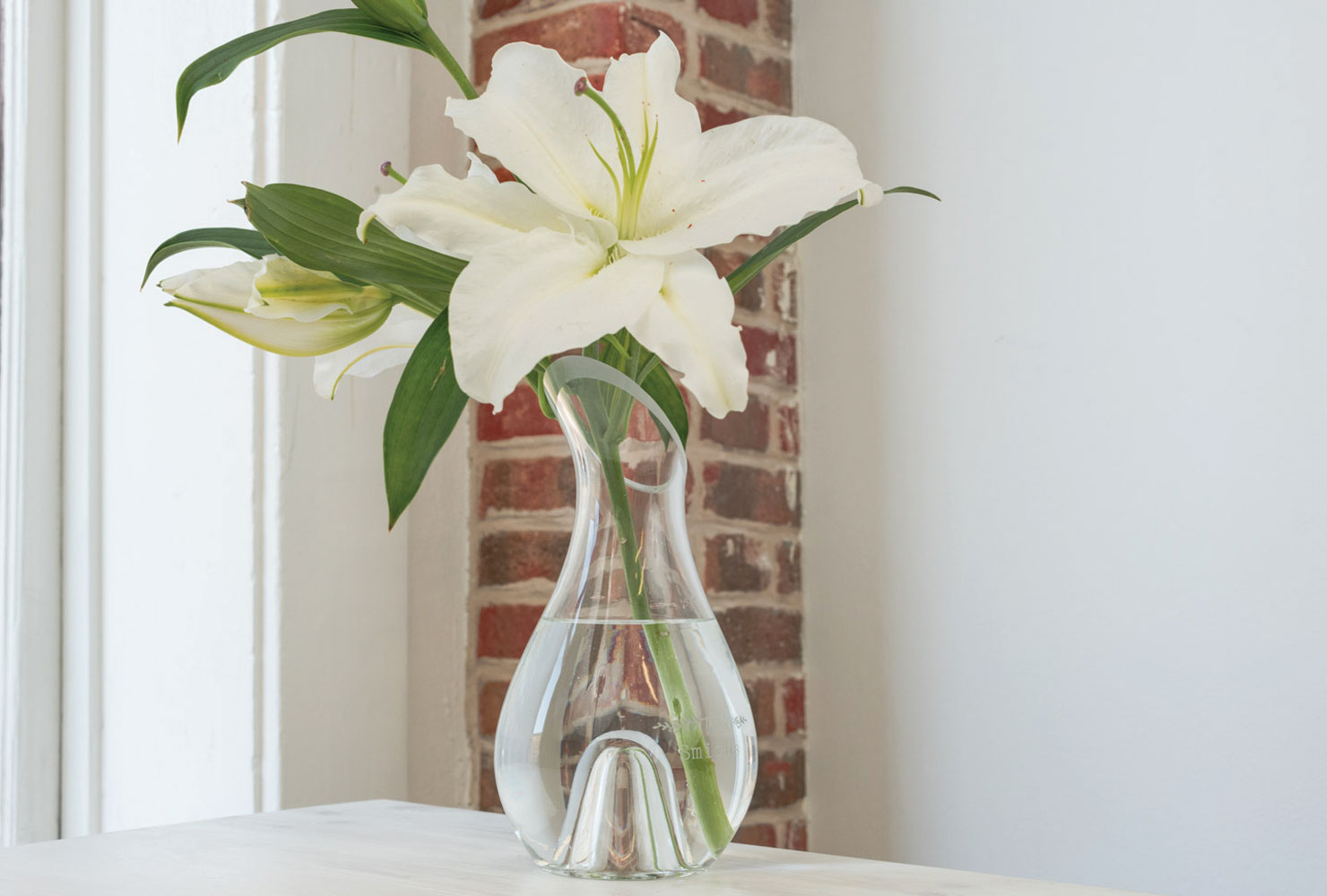 flower in vase sits on table