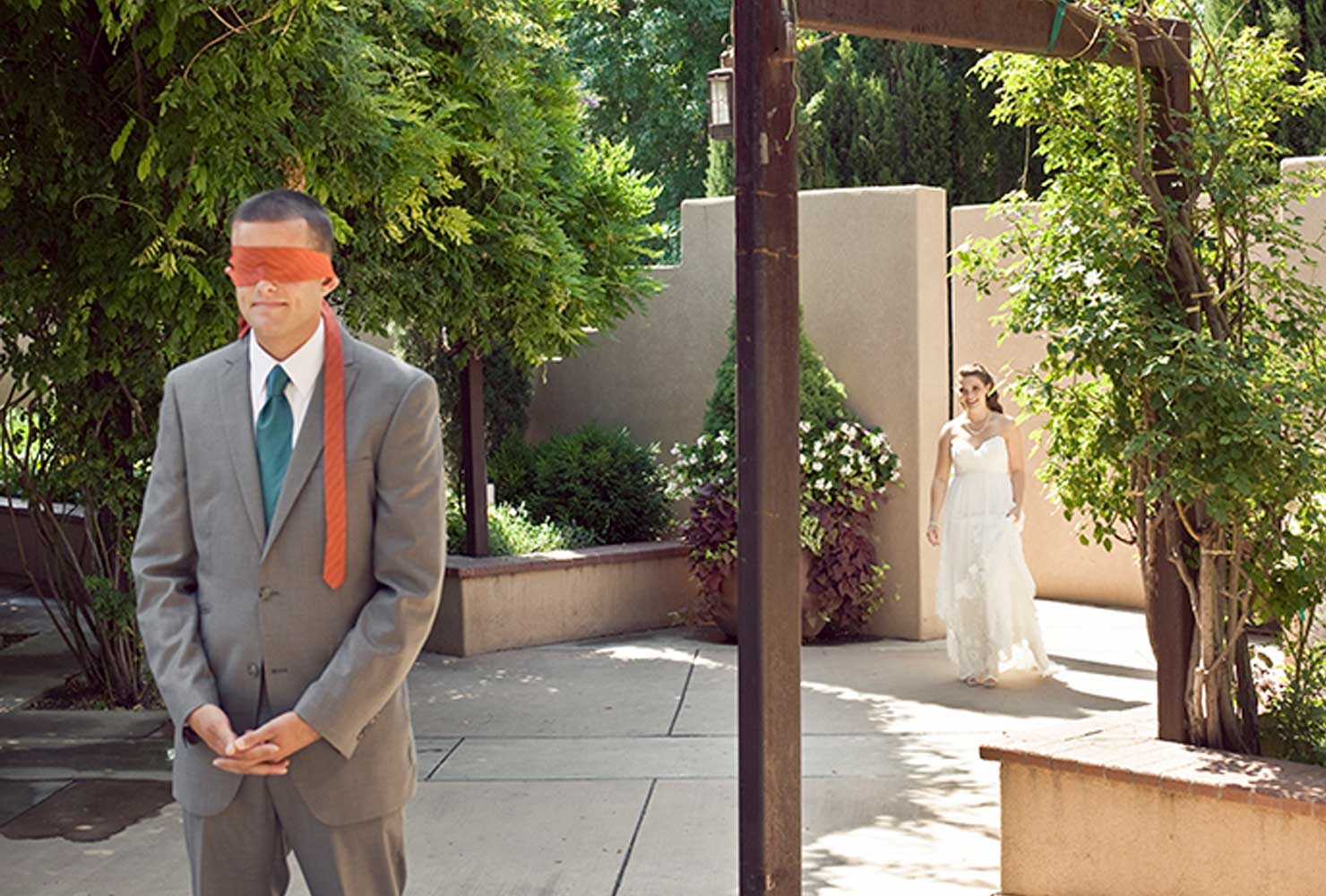 Groom with orange tie blindfold