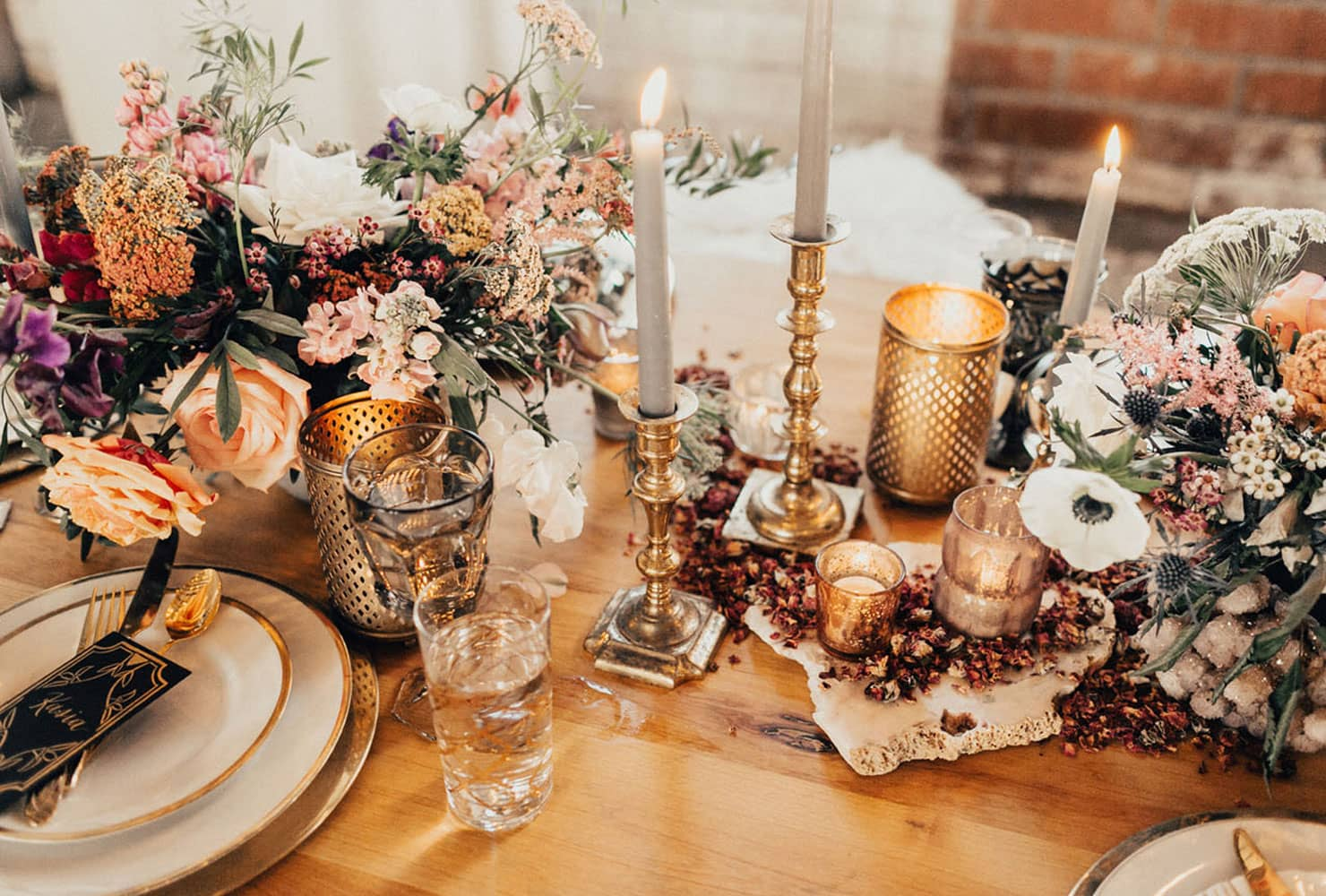 Wood table with bohemian florals and gold candles