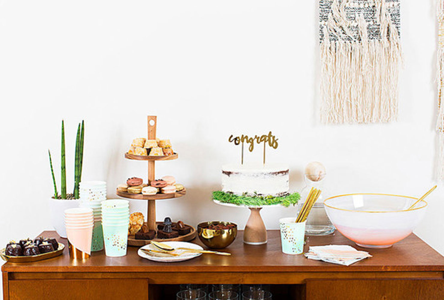 Wooden tablescape with green and gold accents