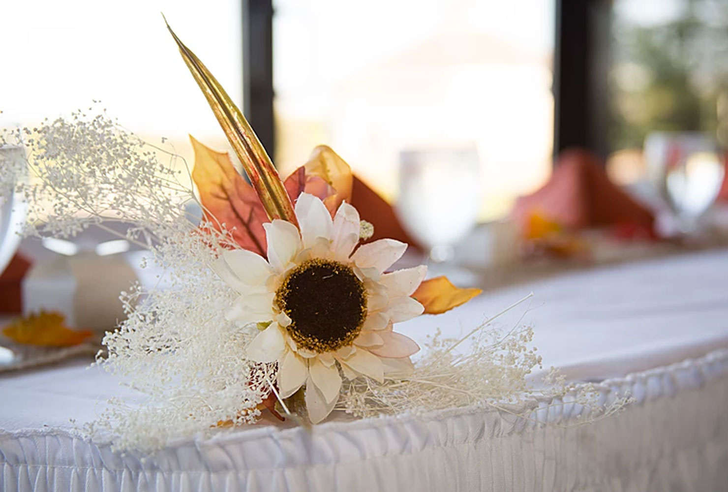 White sunflower centerpiece with autumn leaves