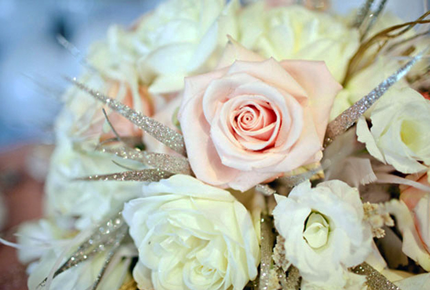 White and blush floral arrangement with silver glitter accents