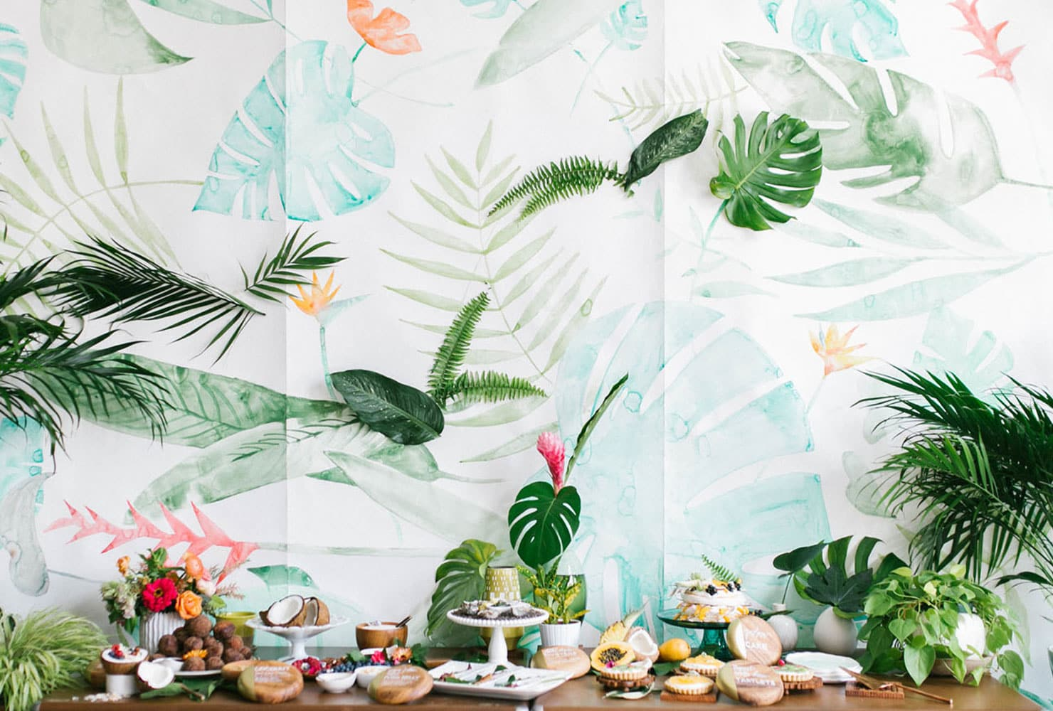 Tropical tablescape with palm leaves and coconut accents