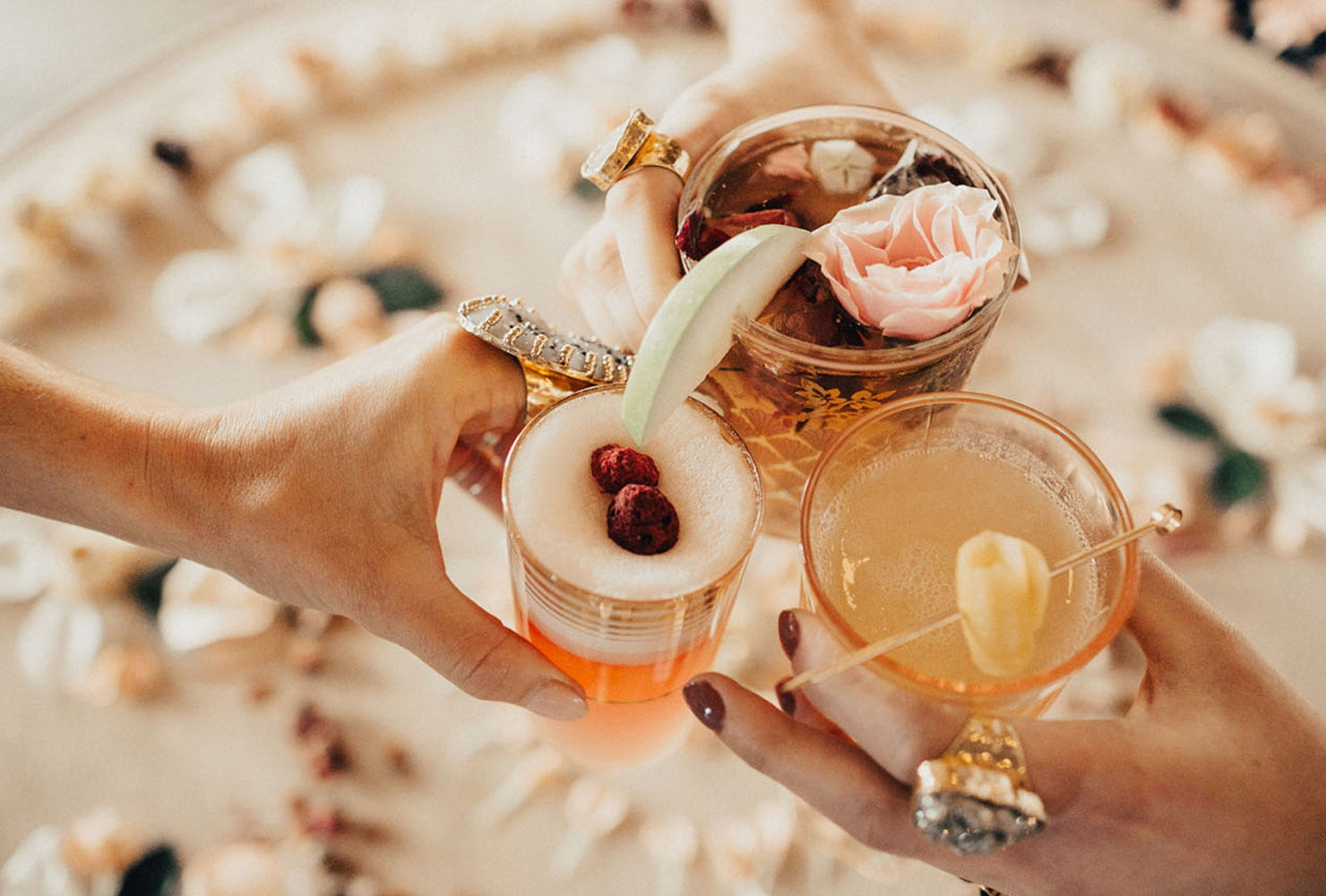 Specialty cocktails with flower and fruit garnishes