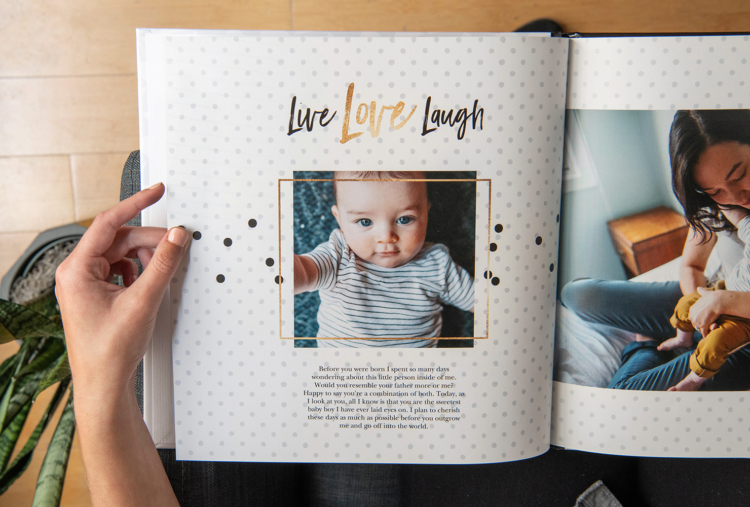 person holding a custom baby photo book with hardcover