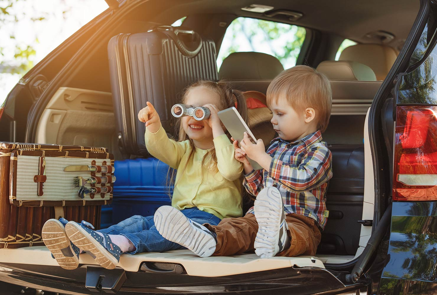 kids in the back of a car on a roadtrip