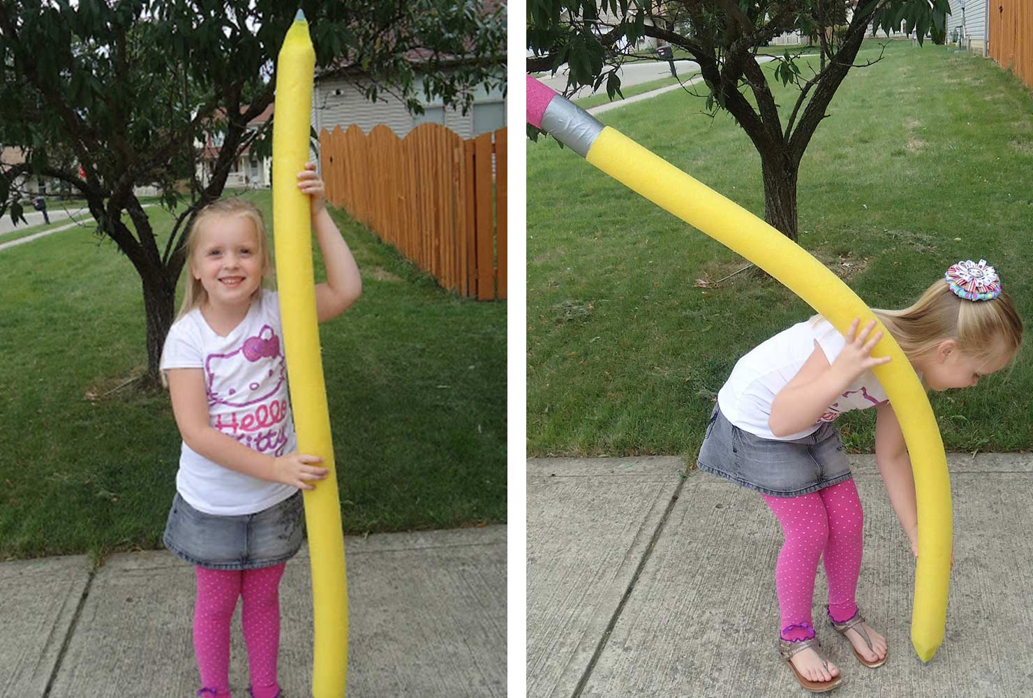 young blonde girl holding large homemade pencil prop