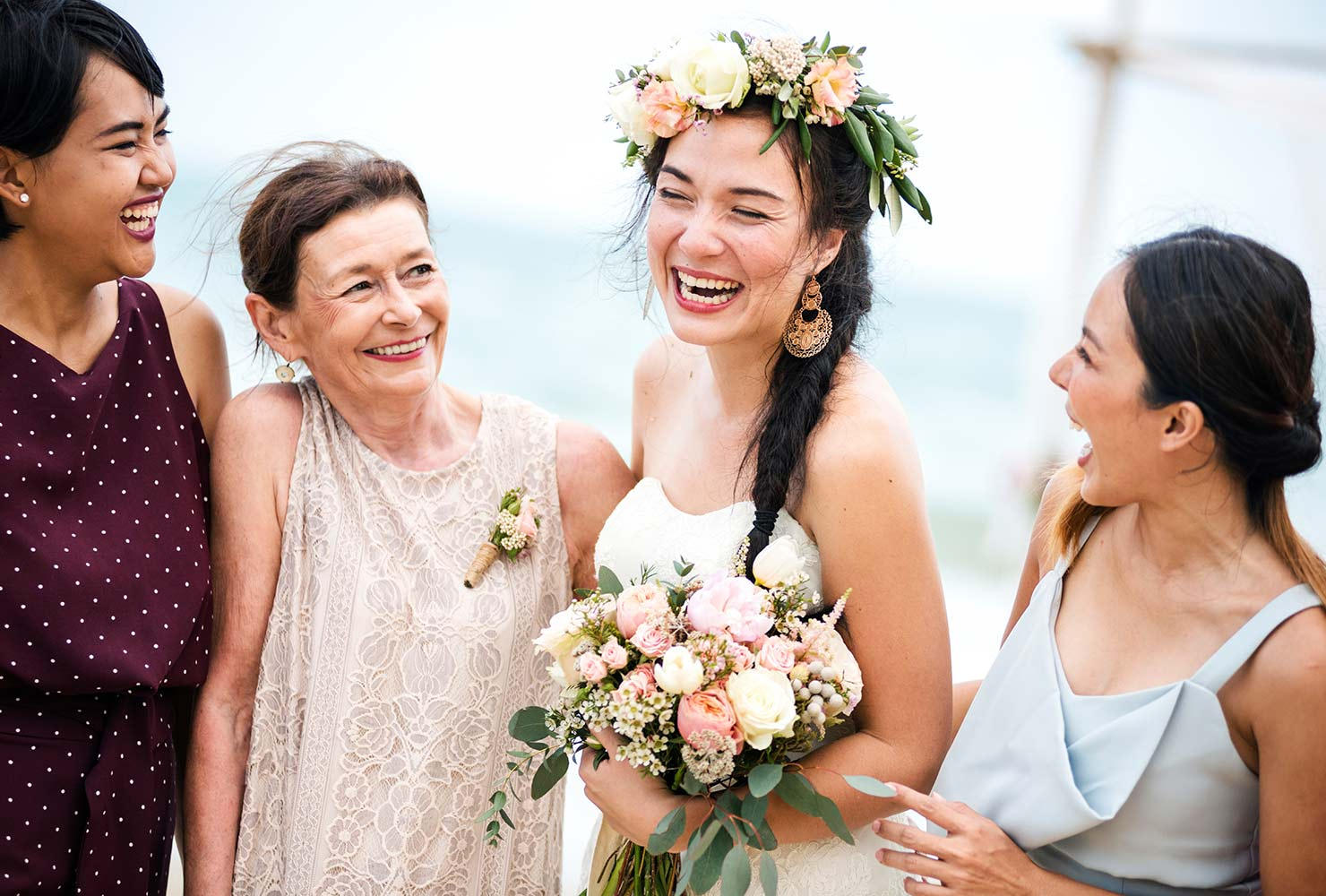 bride with flower crown surrounded by her smiling family