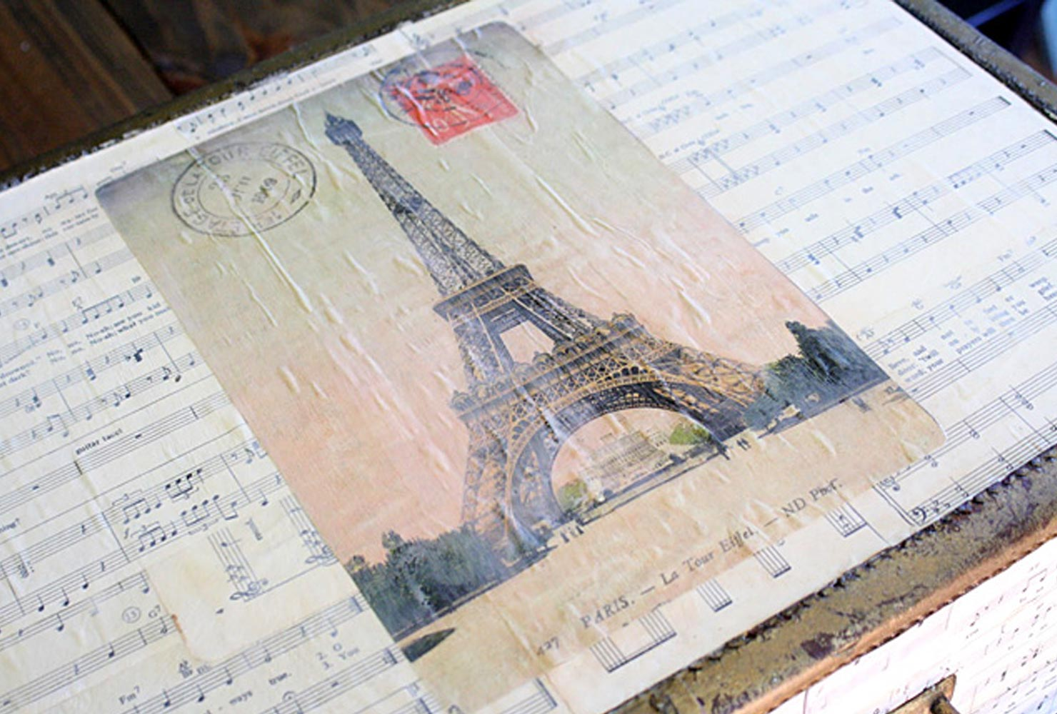 suitcases covered in sheet music