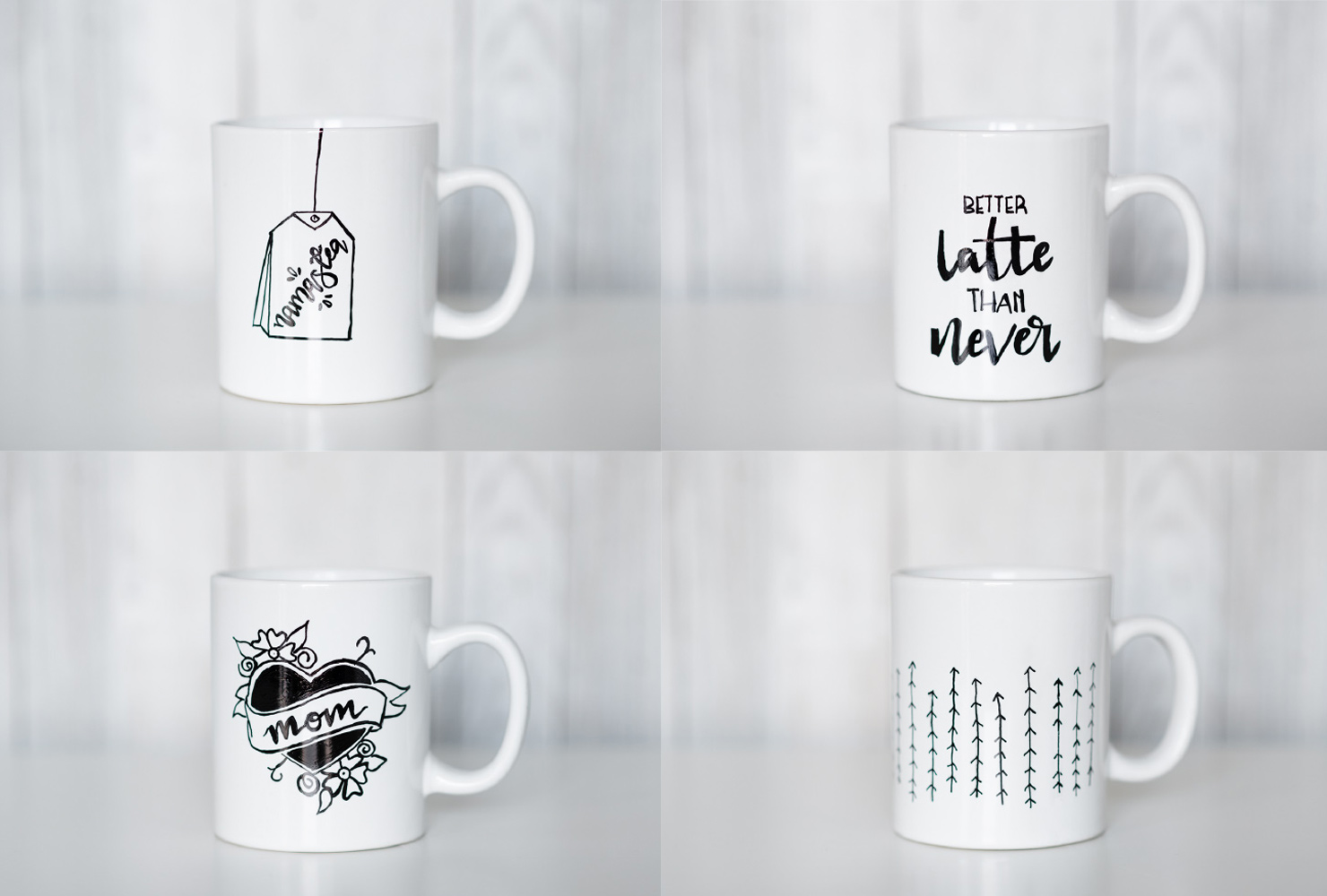 four mugs decorated with marker drawings