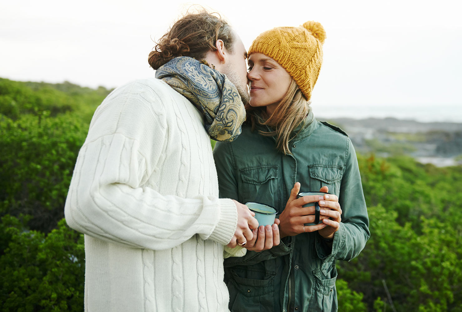couple camping and drinking coffee