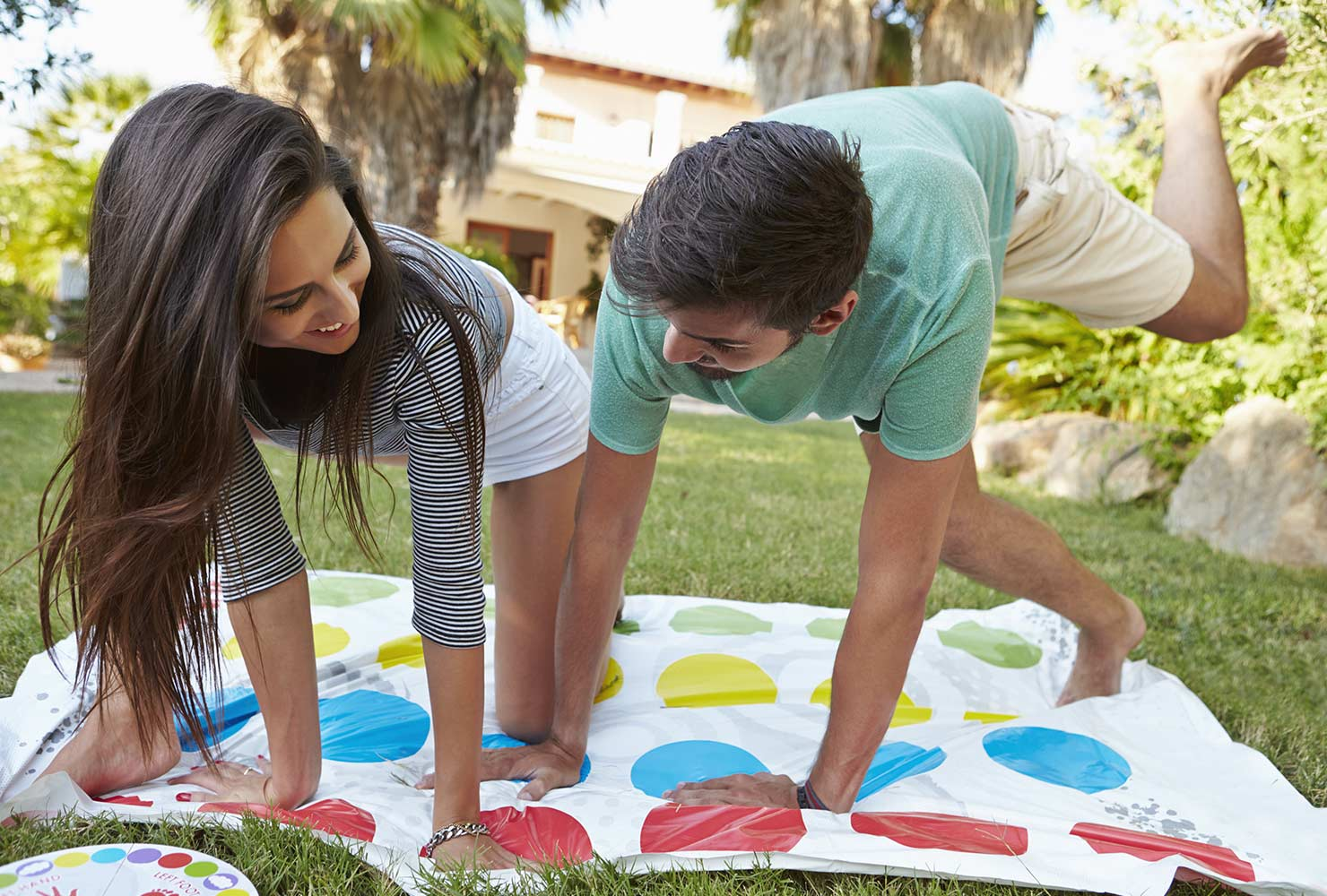 couple playing twister outside