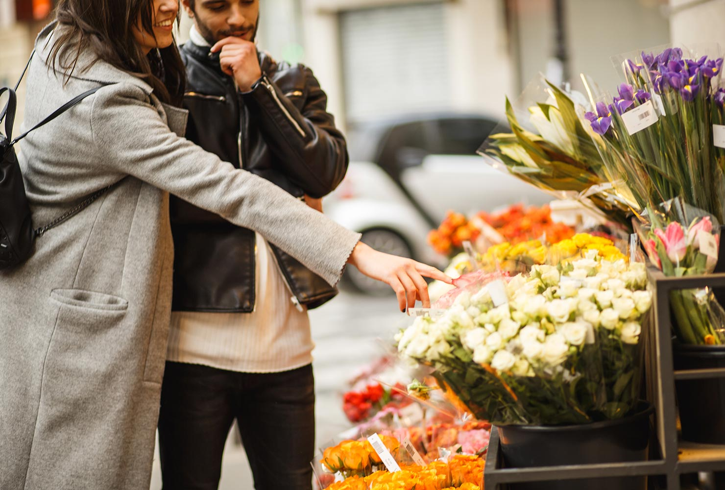 couple looking at flowers at a street fair