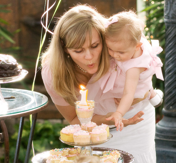 baby girl blowing out candle