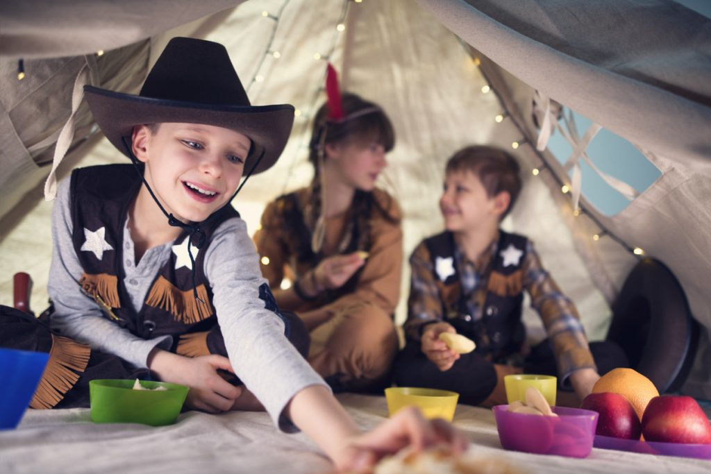 Friends having cowboy party party in a tent.