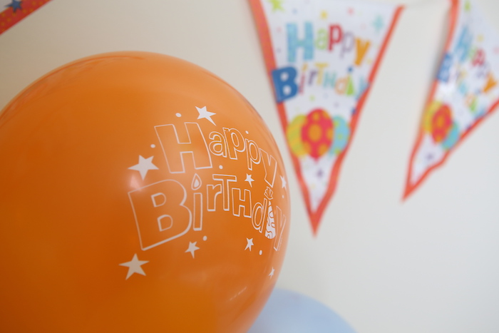 orange birthday balloon
