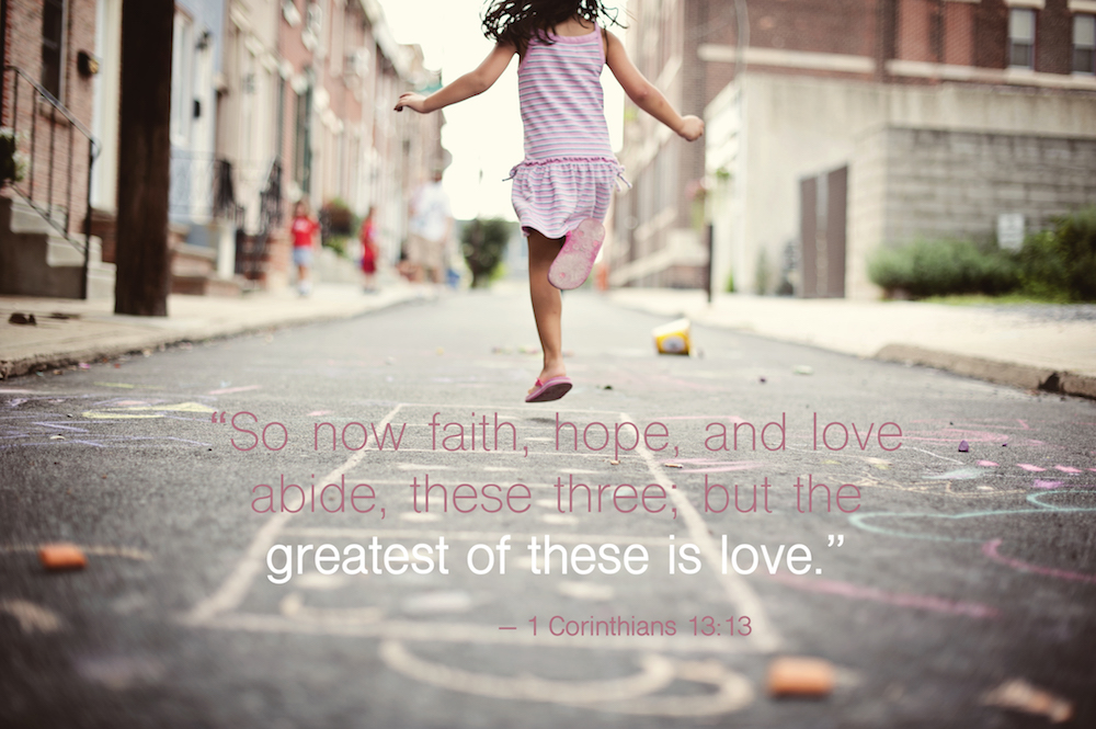 child skipping with faith, hope, love bible quote.