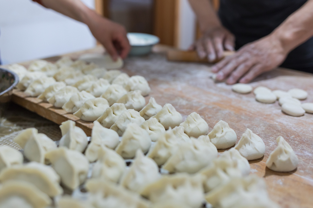 a familky makes dumplings for their family traditions