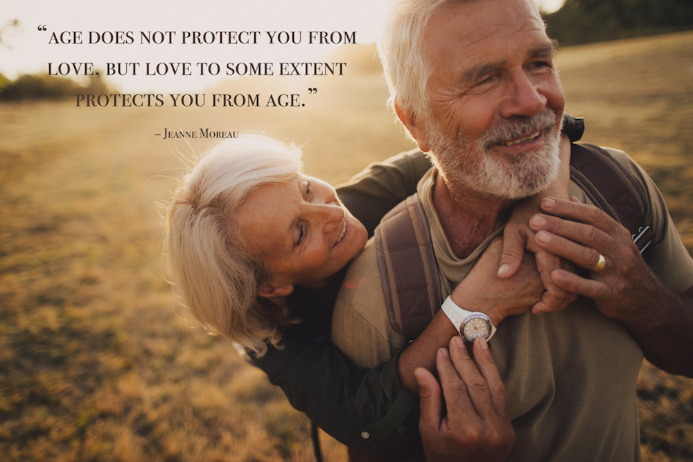 an elderly couple, still very much in love, with a love quote