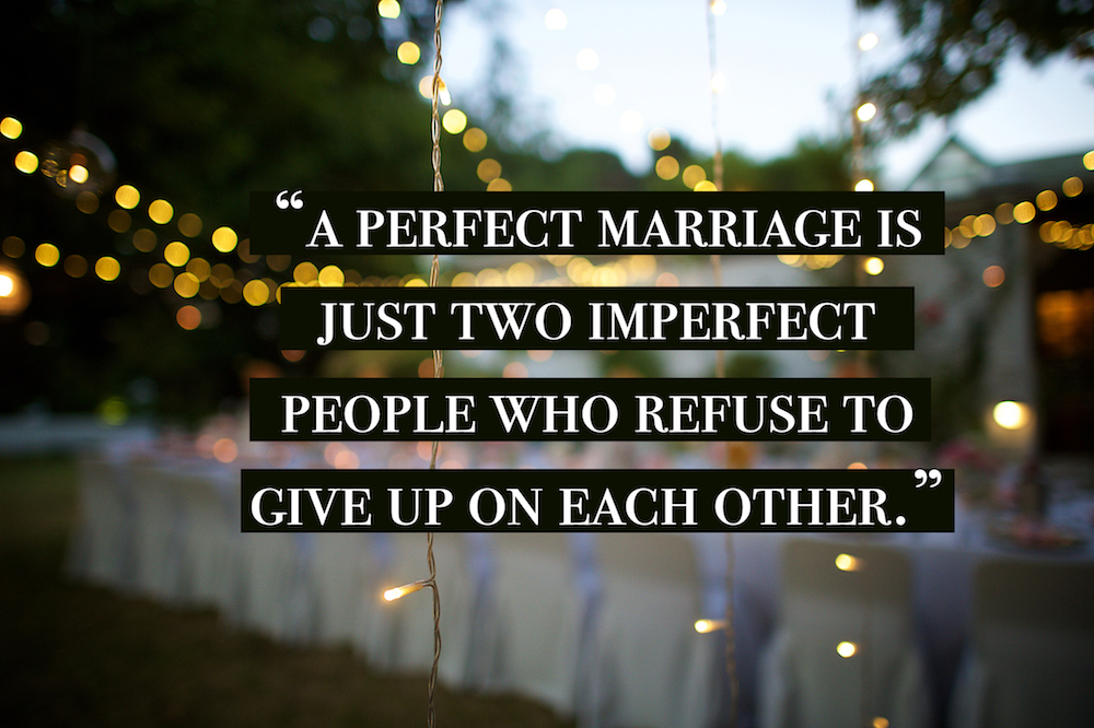 Marriage quotes over a wedding set up and lights