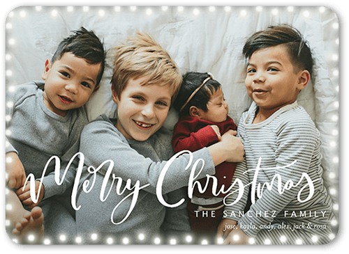 Light frame holiday card with festive christmas lights around the boarder with featured kids