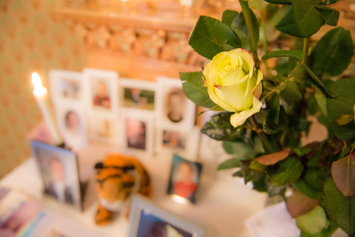 Yellow flower in memorial event for examples of celebration of life invitation wording.