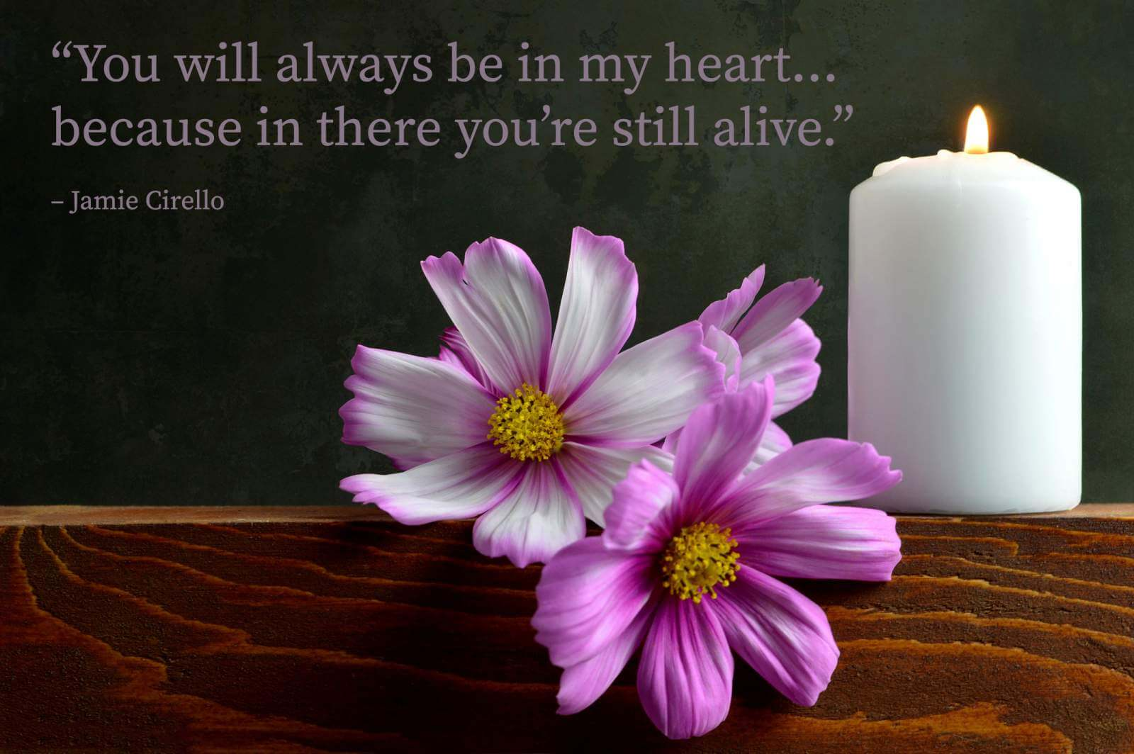 White burning candle and flowers with a miss you dad quote overlay