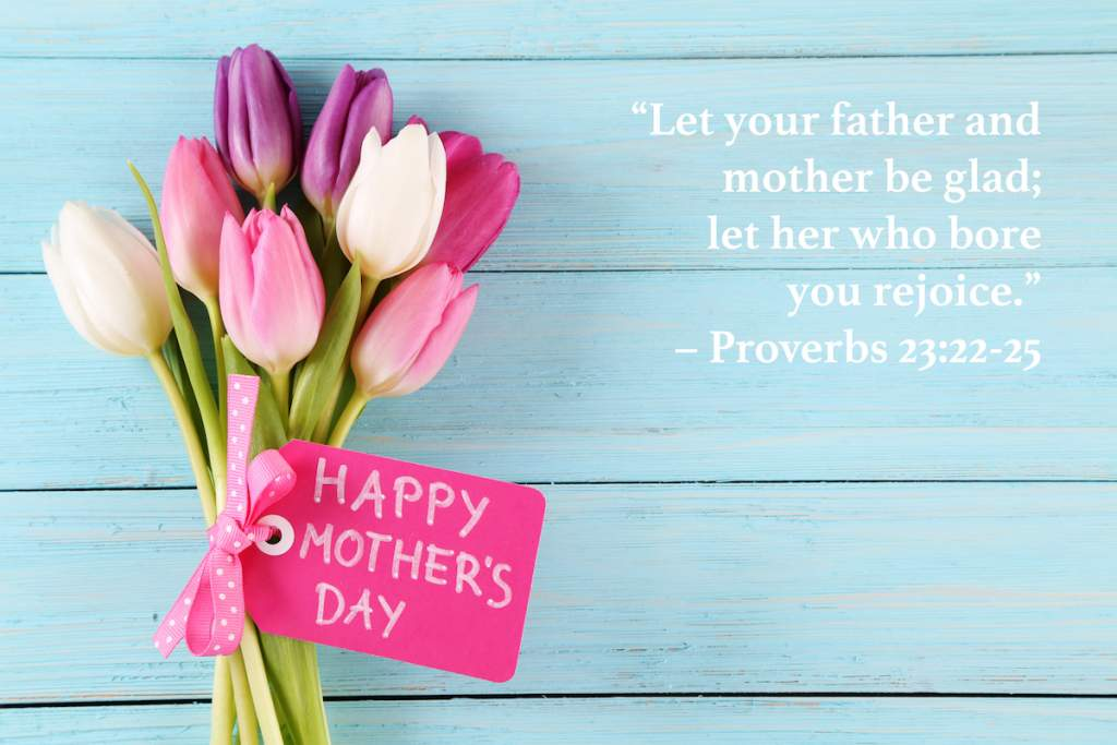 mother's day flowers and pink card with bible verse