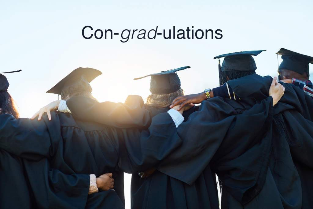 Rearview shot of a group of students standing in a row on graduation day