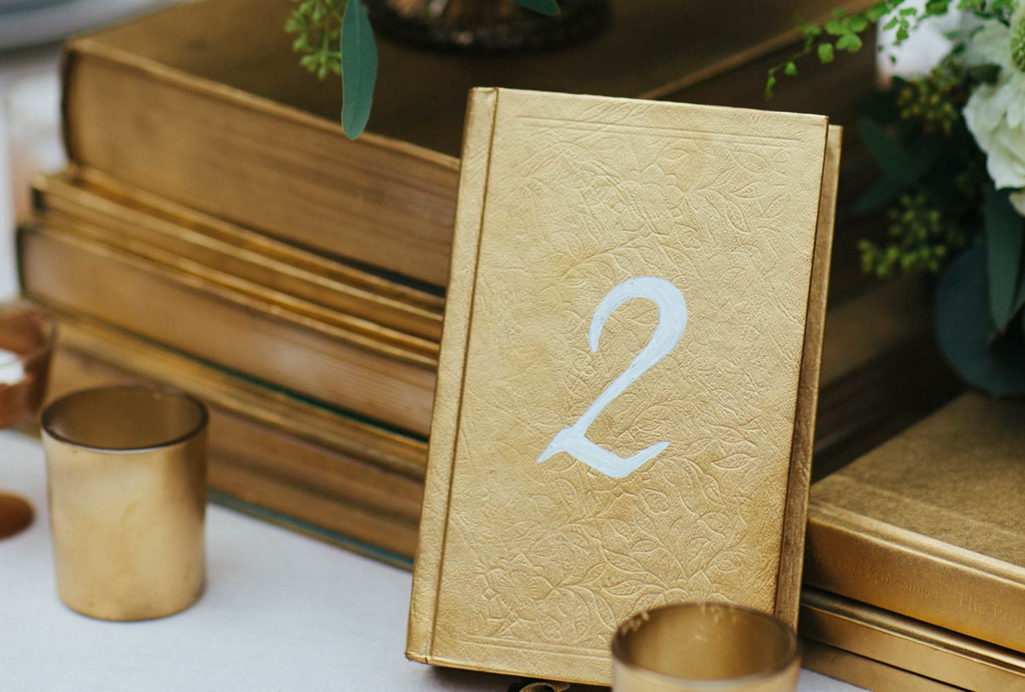 gold table number at wedding