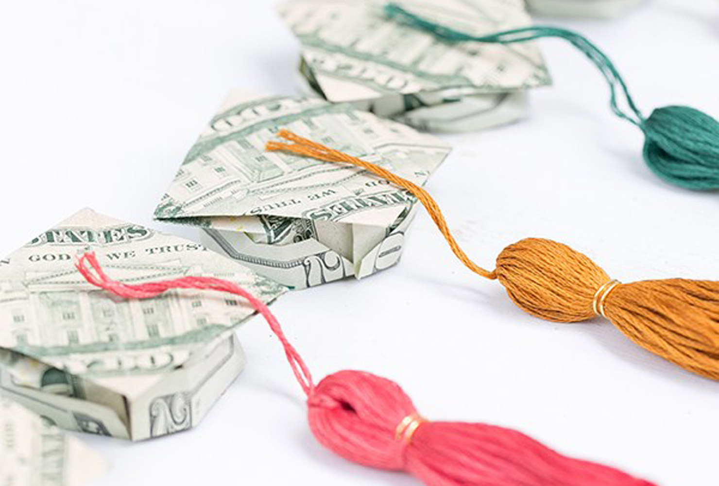 folded money graduation caps