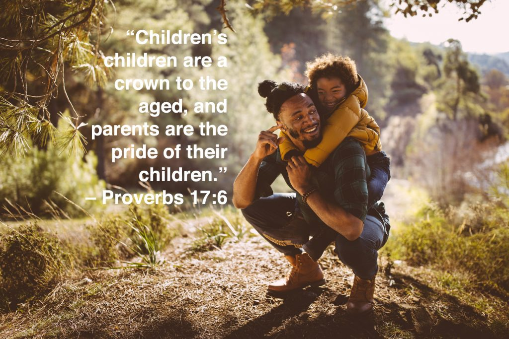 Dad and son bonding and having fun with piggyback ride on mountain with children quotes overlay
