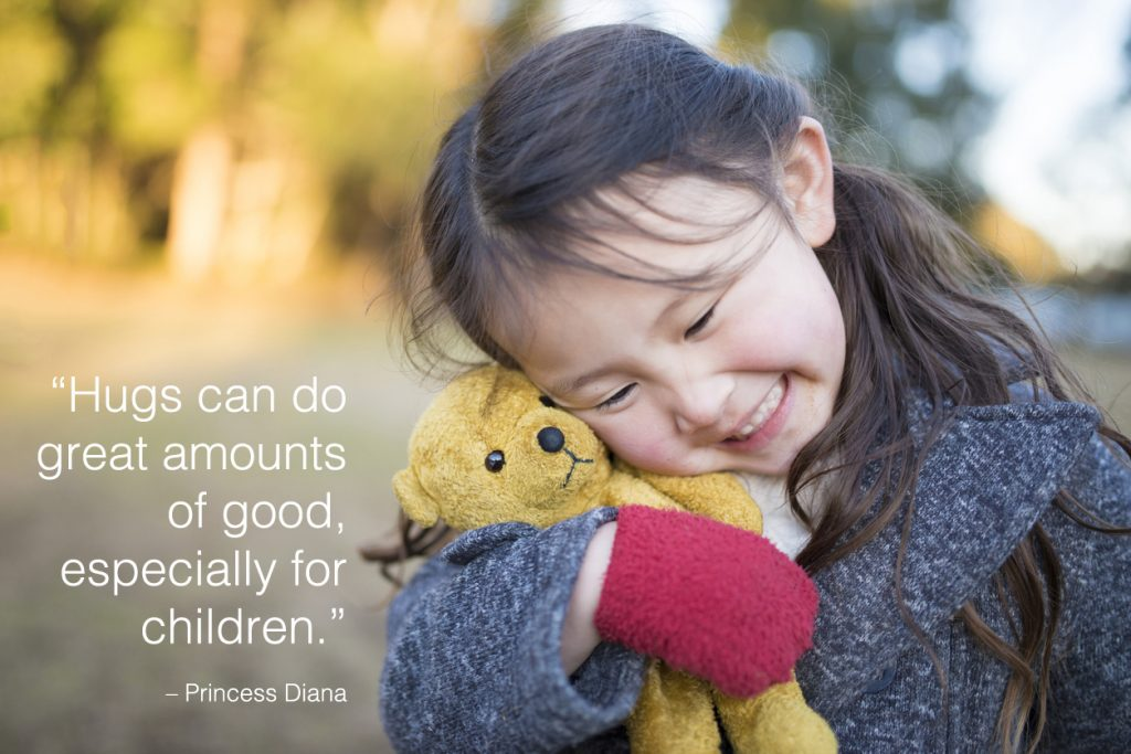 Little girl happy to have a teddy bear with children quotes overlay