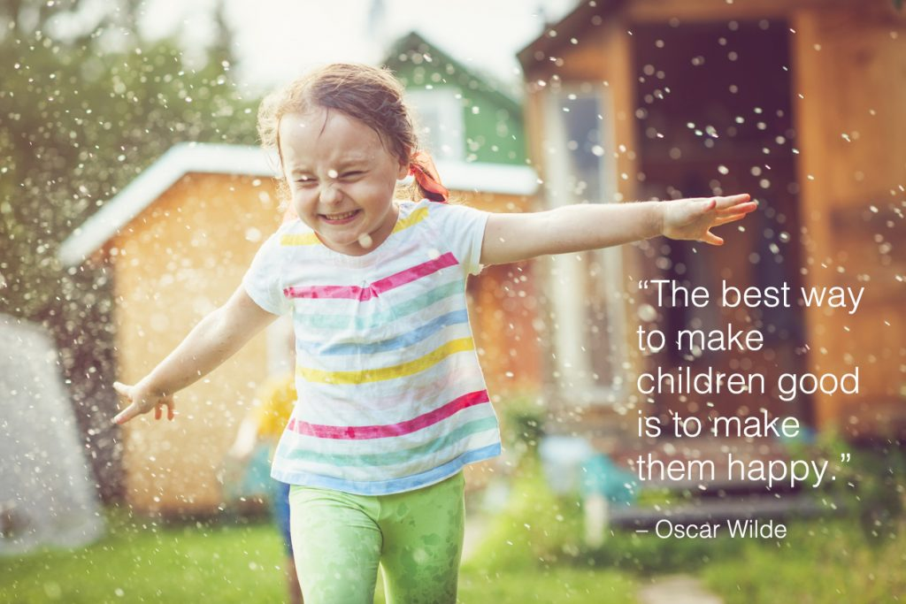 Cute child playing with garden sprinkler with children quotes overlay