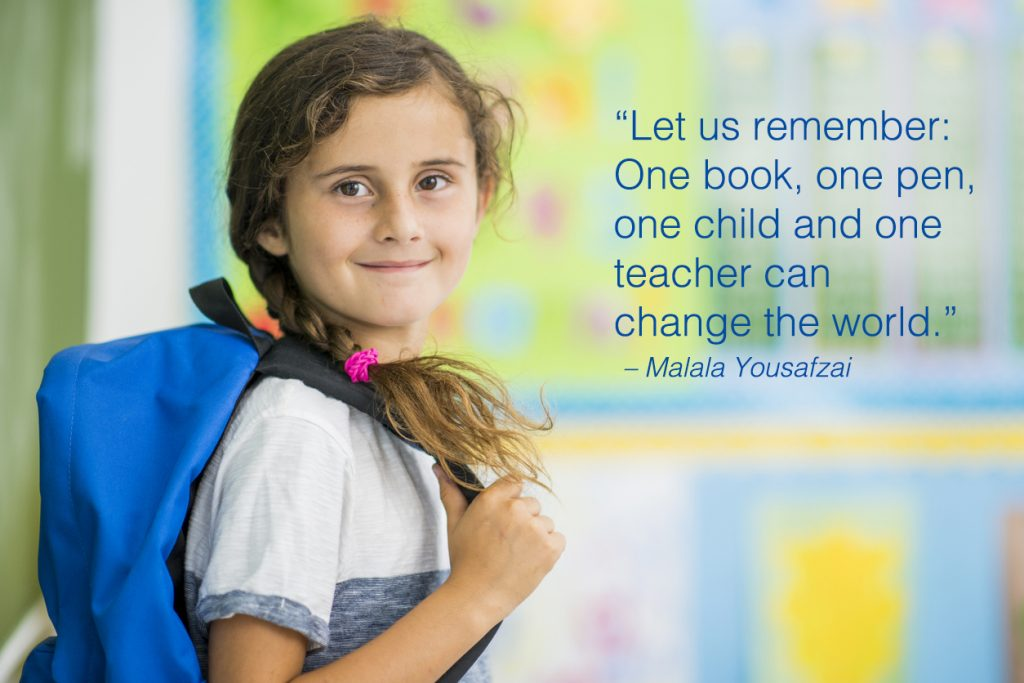 Elementary school girl is indoors in a classroom with school quotes overlay.